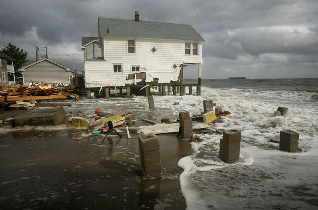 Concrete block pillars are all that is left of a waterfront home destroyed by Hurricane Sandy, off Broadway in Milford on Tuesday, October 30, 2012. Photo: Brian A. Pounds