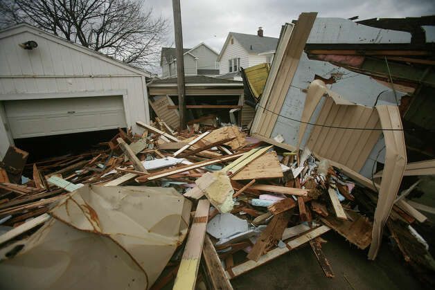 Rubble is all that is left of a waterfront home destroyed by Hurricane Sandy off Broad way in Milford on Tuesday, October 30, 2012. Photo: Brian A. Pounds