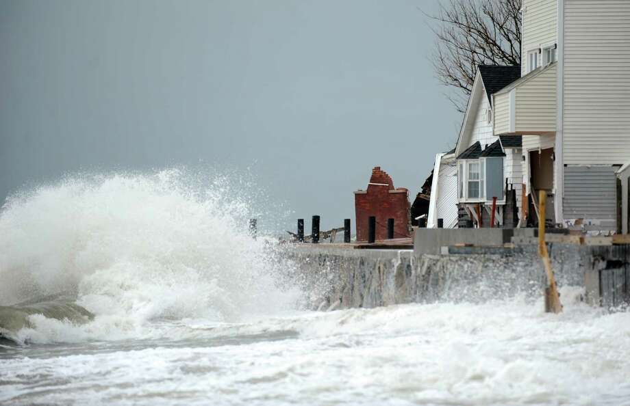 A chimney stands alone beside boarded up houses on Fairfield Beach Road during high tide Tuesday, Oct. 30, 2012 in Fairfield, Conn. Photo: Autumn Driscoll