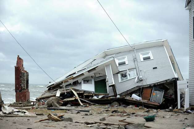 A house destroyed during Hurricane Sandy Tuesday, Oct. 30, 2012 on Fairfield Beach Road in Fairfield, Conn. Photo: Autumn Driscoll