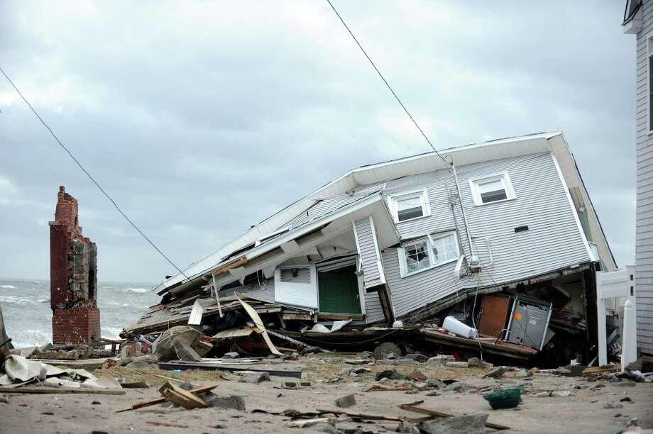 A house destroyed during Hurricane Sandy Tuesday, Oct. 30, 2012 on Fairfield Beach Road in Fairfield, Conn. Photo: Autumn Driscoll