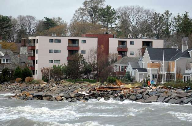 Debris washed onto South Pine Creek Beach from Hurricane Sandy Tuesday, Oct. 30, 2012 in Fairfield, Conn. Photo: Autumn Driscoll