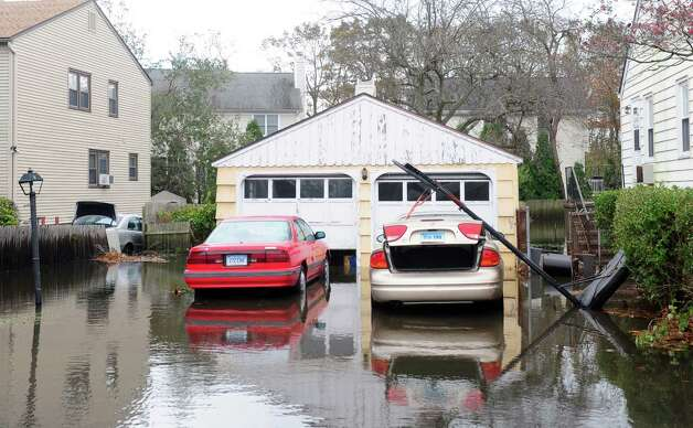 Flooding on Mellow Street Tuesday, Oct. 30, 2012 in Fairfield, Conn. Photo: Autumn Driscoll