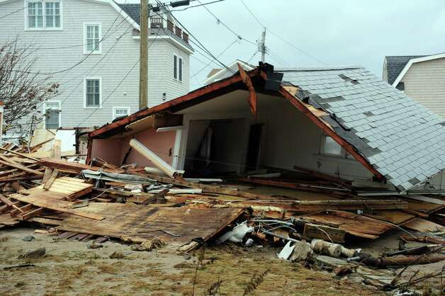 Damage from Hurricane Sandy Tuesday, Oct. 30, 2012 on Fairfield Beach Road in Fairfield, Conn. Photo: Autumn Driscoll