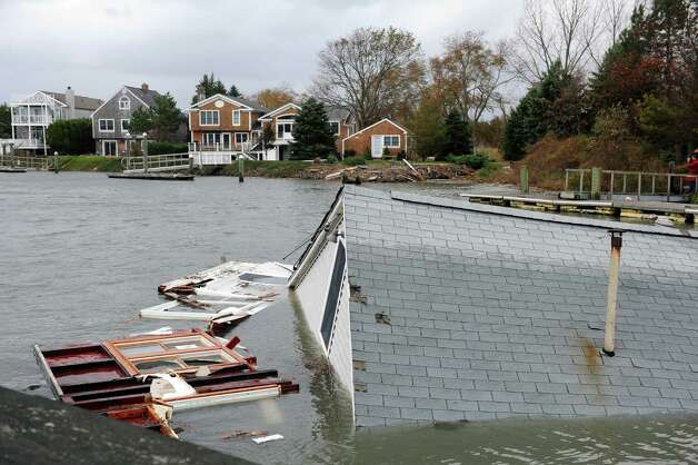 A house destroyed during Hurricane Sandy floats down Pine Creek Tuesday, Oct. 30, 2012 off Fairfield Beach Road in Fairfield, Conn. Photo: Autumn Driscoll
