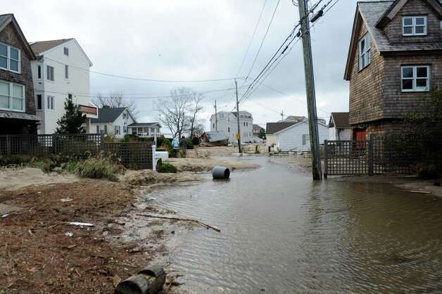 Flood waters from Hurricane Sandy Tuesday, Oct. 30, 2012 on Fairfield Beach Road in Fairfield, Conn. Photo: Autumn Driscoll