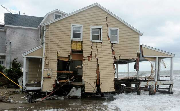 A house damaged during Hurricane Sandy Tuesday, Oct. 30, 2012 on Fairfield Beach Road in Fairfield, Conn. Photo: Autumn Driscoll