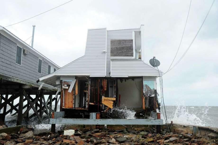 A house damaged during Hurricane Sandy Tuesday, Oct. 30, 2012 on Fairfield Beach Road in Fairfield, Conn. Photo: Autumn Driscoll