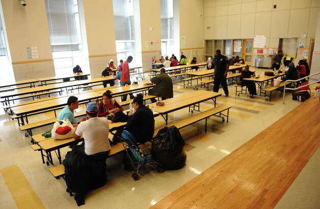 Area residents eat lunch in the cafeteria at the shelter set up at Jettie Tisdale School in Bridgeport, Conn. on Tuesday October 30, 2012. Photo: Christian Abraham