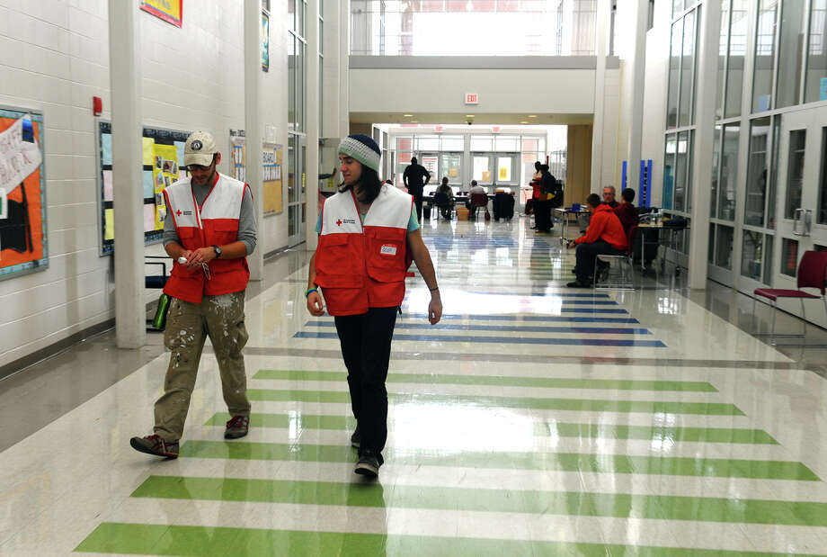 Red Cross volunteers Ben Dillon, left, and Geoff Connors at work at the shelter set up at Jettie Tisdale School in Bridgeport, Conn. on Tuesday October 30, 2012. Photo: Christian Abraham