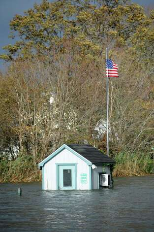The guard shack at the entrance  to South Benson Marina in Fairfield, Conn. remained in high water on Tuesday, Oct. 30, 2012. Storm surge from Hurricane Sandy flooded the area. Photo: Mark Conrad