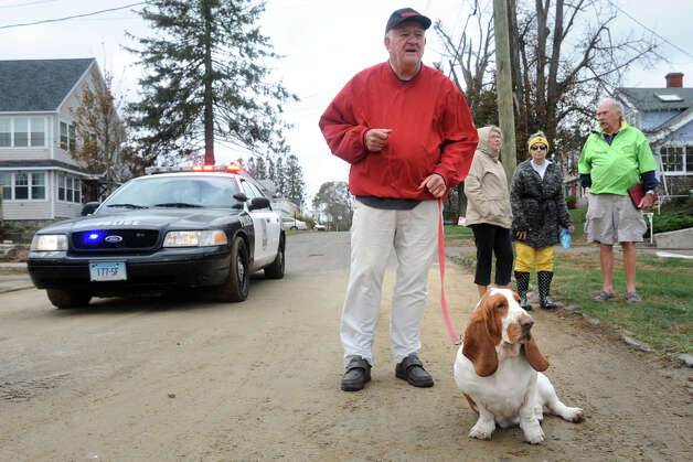 Dan DoBas and his basset hound Nick join neighbors as they survey storm damage in the Lordship section of Stratford, Conn. following Hurricane Sandy Oct. 30th, 2012. Photo: Ned Gerard
