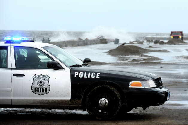 Police stand gaurd along a flooded section of Beach Ave. in the Lordship section of Stratford, Conn. following Hurricane Sandy Oct. 30th, 2012. Photo: Ned Gerard