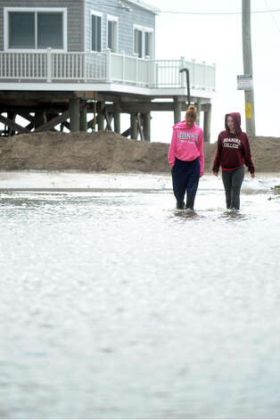 Keely Young and Payton Barta walk in a flooded section of 5th Ave. in the Lordship section of Stratford, Conn. following Hurricane Sandy Oct. 30th, 2012. Photo: Ned Gerard
