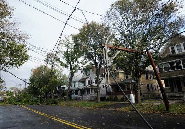 A tree knocked down a telephone pole on Park Ave. in Bridgeport, Conn. during the height of the wicked weather caused by Hurricane Sandy.This section of Park Ave. between Maplewood and Beechwood Ave. remained closed on Tuesday, Oct. 30, 2012. Photo: Cathy Zuraw