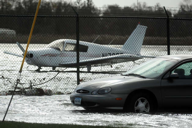 A car and an airplane sit in flood water at Sikorsky Memorial Airport in Stratford, Conn. following Hurricane Sandy Oct. 30th, 2012. Photo: Ned Gerard