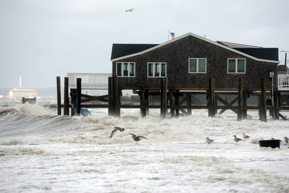 Waves at high tide surge around beach front homes in the Lordship section of Stratford, Conn. following Hurricane Sandy Oct. 30th, 2012. Photo: Ned Gerard