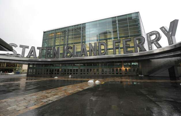The Staten Island Ferry terminal at Battery Park in lower Manhattan remains closed, Tuesday, Oct. 30, 2012, in New York. New York City awakened Tuesday to a flooded subway system, shuttered financial markets and hundreds of thousands of people without power a day after a wall of seawater and high winds slammed into the city, destroying buildings and flooding tunnels. (AP Photo/Louis Lanzano) Photo: Louis Lanzano