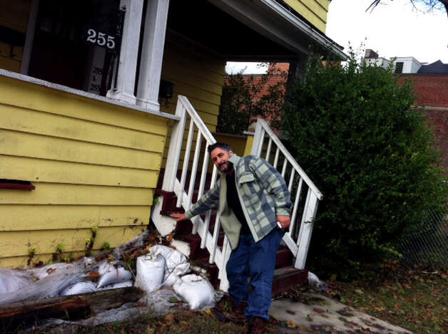 Raman Montanaro shows where the water level was in front of his house at the foot of Lafayette Blvd. in Bridgeport, Conn. on Tuesday, Oct. 30, 2012, after the flooding from Hurricane Sandy.Two years ago FEMA forced him to buy flood insurance. He's had to use it twice since. Photo: Linda Conner Lambeck