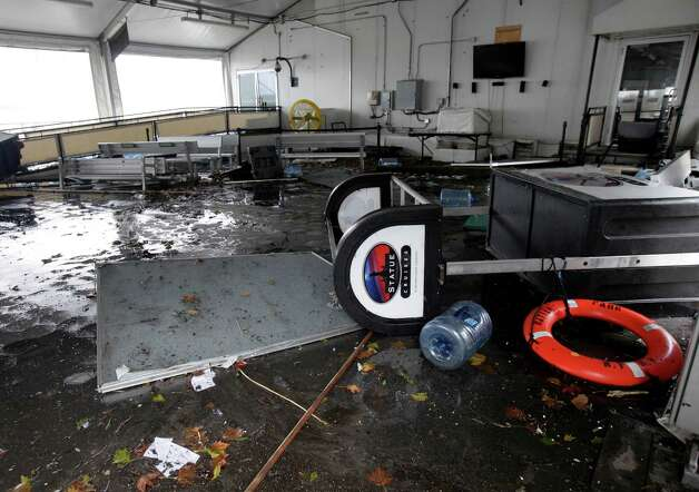 The passenger terminal for a ferry that takes passengers to the Statue of Liberty,in Battery Park is in shambles from superstorm Sandy, in New York, Tuesday, Oct. 30, 2012.  (AP Photo/Richard Drew) Photo: Richard Drew