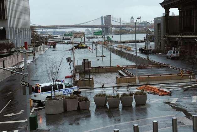 CORRECTS NAME OF FLOODED AREA TO BATTERY PARK UNDERPASS INSTEAD OF BROOKLYN BATTERY TUNNEL - Water reaches the street level of the Battery Park Underpass, Tuesday, Oct. 30, 2012, in New York. Sandy arrived along the East Coast and morphed into a huge and problematic system, putting more than 7.5 million homes and businesses in the dark and causing a number of deaths. (AP Photo/Louis Lanzano) Photo: Louis Lanzano