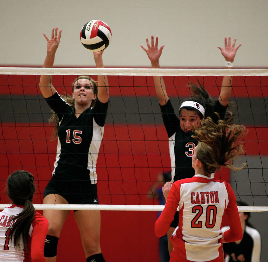 Churchill's Shelby Arnold, left, and Tori Guerra go up against New Braunfels Canyon's Megan Isbell, right, during their Class 5A first round playoff match at Judson High School on Tuesday, Oct. 30, 2012. Photo: Lisa Krantz, San Antonio Express-News / San Antonio Express-News