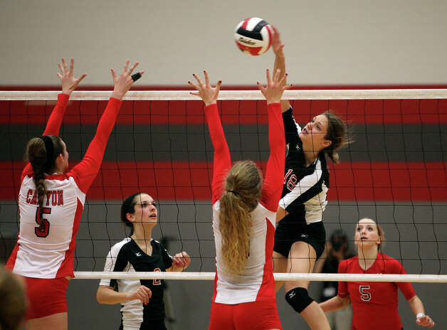 Churchill's Taylor Martinez (18), right, and Karley York, left, go up against New Braunfels Canyon's Rafae Strobos (5), left, and Katie Cavanaugh, during their Class 5A first round playoff match at Judson High School on Tuesday, Oct. 30, 2012. Photo: Lisa Krantz, San Antonio Express-News / San Antonio Express-News