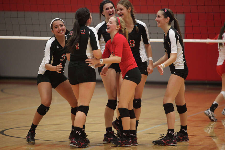Churchill volleyball players, Tori Guerra, from left, Katie Pope, Abby Buckingham, Amy Nettles (red), Taylor Martinez and Karley York celebrate their score against New Braunfels Canyon during their Class 5A first round playoff match at Judson High School on Tuesday, Oct. 30, 2012. Photo: Lisa Krantz, San Antonio Express-News / San Antonio Express-News