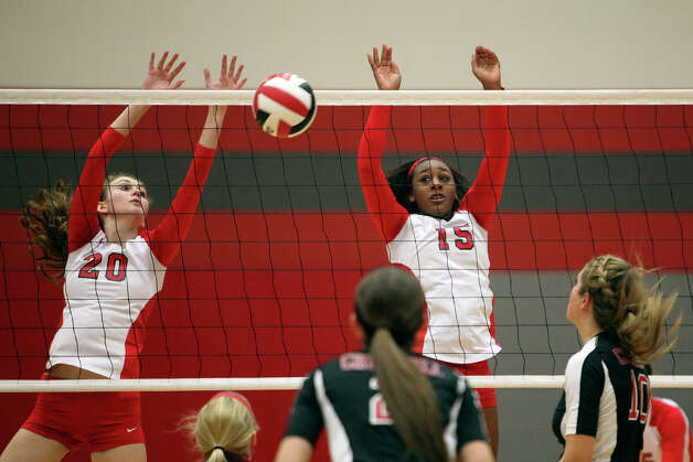 New Braunfels Canyon's Megan Isbell (20), left, and Yanesha Johnson (15), right, take on Churchill during their Class 5A first round playoff match at Judson High School on Tuesday, Oct. 30, 2012. Photo: Lisa Krantz, San Antonio Express-News / San Antonio Express-News