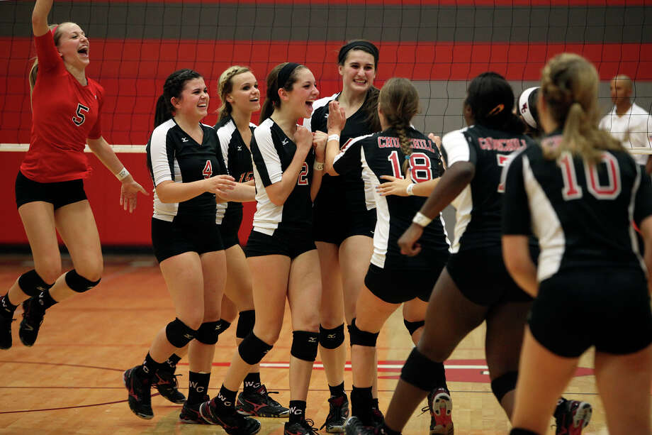 The Churchill volleyball team celebrates their win against New Braunfels Canyon at the conclusion of their Class 5A first round playoff match at Judson High School on Tuesday, Oct. 30, 2012. Photo: Lisa Krantz, San Antonio Express-News / San Antonio Express-News