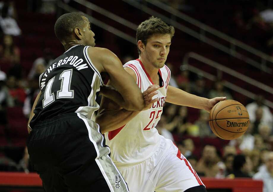 The Houston Rockets Chandler Parsons right, drives past the San Antonio Spurs Wesley Witherspoon during the first quarter of NBA preseason game action at the Toyota Center Sunday, Oct. 14, 2012, in Houston.  ( James Nielsen / Chronicle ) Photo: James Nielsen, Staff / © Houston Chronicle 2012