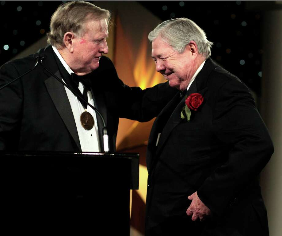"B.J. ""Red"" McCombs, left, welcomes Frank A. Bennack Jr., CEO of Hearst Corp., as one of five new inductees into the Texas Business Hall of Fame at the Hilton Americas on Tuesday. Photo: Billy Smith II, Staff / Houston Chronicle"