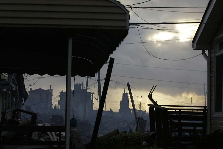 Damage caused by a fire at Breezy Point is shown Tuesday, Oct. 30, 2012, in the aftermath of superstorm Sandy, in the New York City borough of Queens. The fire destroyed between 80 and 100 houses Monday night in the flooded neighborhood. (AP Photo/Frank Franklin II) Photo: Frank Franklin II, Associated Press
