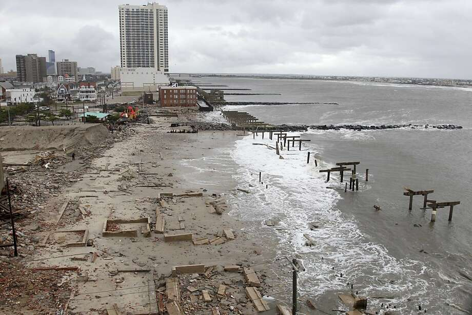Foundations and pilings are all that remain of brick buildings and a boardwalk in Atlantic City, N.J., Tuesday, Oct. 30, 2012, after they were destroyed when a powerful storm that started out as Hurricane Sandy made landfall on the East Coast on Monday night. (AP Photo/Seth Wenig) Photo: Seth Wenig, Associated Press