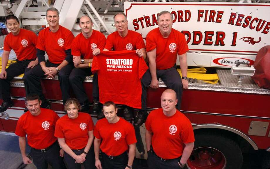"""Stratford firefighters are taking part in the Red Shirt Friday program which encourages people to wear red shirts on Fridays to show support for American troops.  The fire department's usual blue t-shirts were replicated in red and """"Support Our Troops"""" was added to the back of the shirts.  Clockwise from top left  is Garvin Yu, Lt. Jim Mecozzi, Stephen O'Hara, Mike Preston, Mike Tiberio, Jason Carrafiello, Adam Hittinger, Asst. Chief Ellen Murray and Ray Hessels. Photo: Autumn Driscoll / Connecticut Post"""