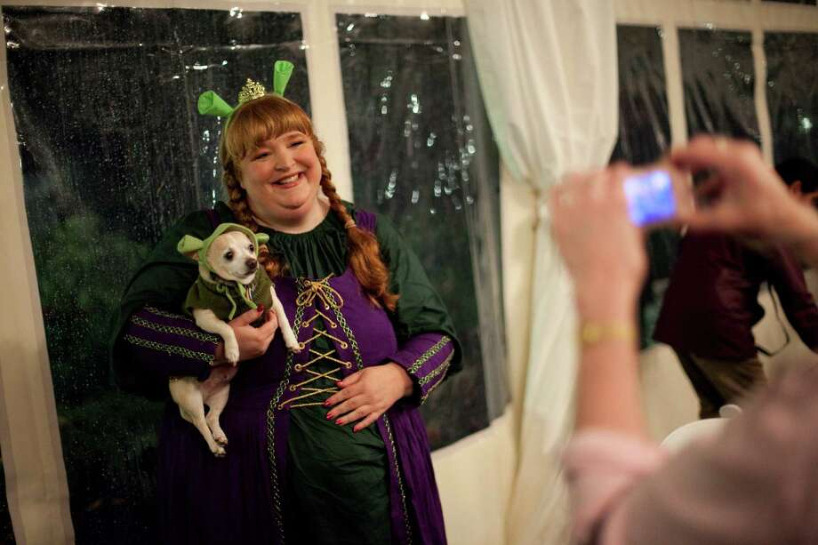 Chihuahua Louie, dressed as Shrek, and Cindy Lance, dressed as Fiona, are photographed during the CityDog Magazine inaugural Howl-at-the-Moon Muttmixer at the Woodmark Hotel in Kirkland on Tuesday, October 30th, 2012. Dozens of dogs in costume attended the event. Photo: JOSHUA TRUJILLO / SEATTLEPI.COM