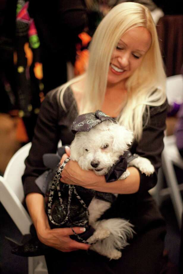 Veronica Olpinski holds her dog Sadie during the CityDog Magazine inaugural Howl-at-the-Moon Muttmixer at the Woodmark Hotel in Kirkland on Tuesday, October 30th, 2012. Dozens of dogs in costume attended the event. Photo: JOSHUA TRUJILLO / SEATTLEPI.COM