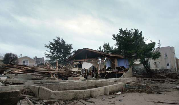 A beachfront house is completely destroyed in the aftermath of yesterday's surge from superstorm Sandy, Tuesday, Oct. 30, 2012, in Coney Island's Sea Gate community in New York. (AP Photo/Bebeto Matthews) Photo: Bebeto Matthews