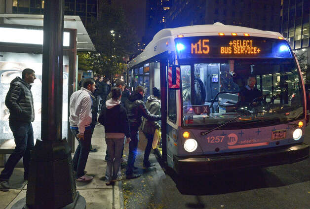 This photo provided by Metropolitan Transportation Authority shows people boarding a bus, as partial bus service was restored on Tuesday, Oct. 30, 2012. Mass transit, including buses, was suspended during Sandy, the storm that made landfall Monday. (AP Photo/Metropolitan Transportation Authority, Patrick Cashin) Photo: Patrick Cashin