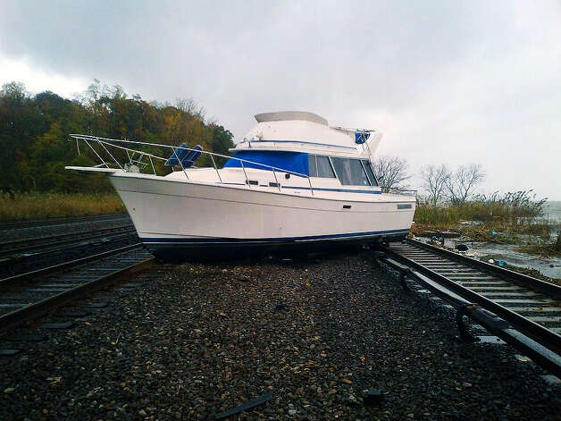 Boat on Metro-North railroad tracks on Hudson line after Hurricane Sandy