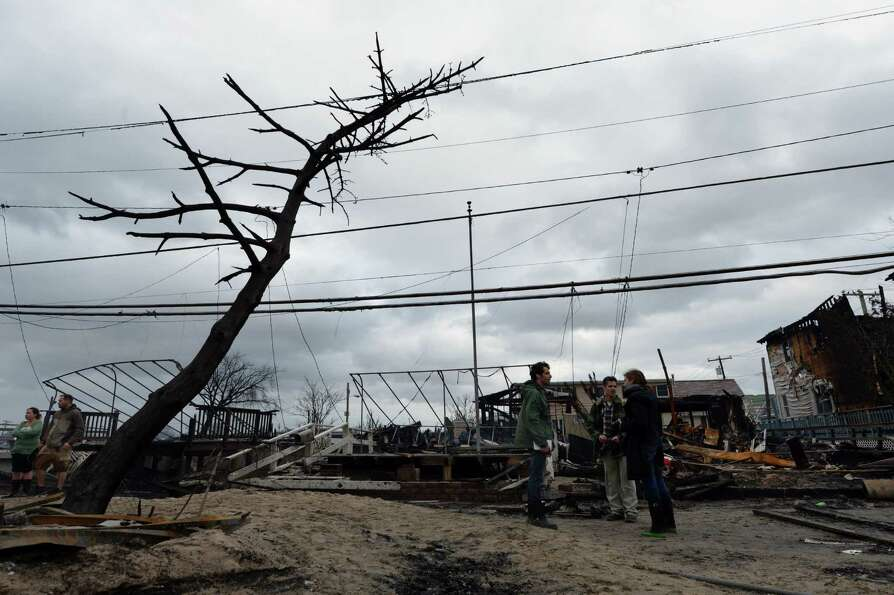 TOPSHOTS People view damage in a neighborhood in the Breezy Point area of Queens in New York on Octo