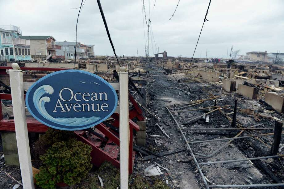 TOPSHOTS  Damage is seen in the Breezy Point area of Queens in New York on October 30, 2012 after fire destroyed about 80 homes as a result of Hurricane Sandy which hit the area on October 29. The death toll from superstorm Sandy has risen to 35 in the United States and Canada, and was expected to climb further as several people remained missing, officials said. Officials in the states of Connecticut, Maryland, New York, New Jersey, North Carolina, Pennsylvania, Virginia and West Virginia all reported deaths from the massive storm system, while Toronto police said a Canadian woman was killed by flying debris.    AFP PHOTO/Stan HONDASTAN HONDA/AFP/Getty Images Photo: STAN HONDA, AFP/Getty Images / AFP