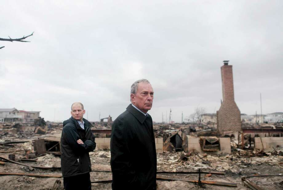 Mayor Michael Bloomberg surveys an area damaged by fire during Hurricane Sandy in the Breezy Point neighborhood of the Queens borough of New York, Oct. 30, 2012. Sandy moved inland Tuesday after grinding life to a halt for millions of people in more than a half-dozen states, leaving behind the daunting task of cleaning up. (Kirsten Luce/The New York Times) Photo: KIRSTEN LUCE, NYT / NYTNS
