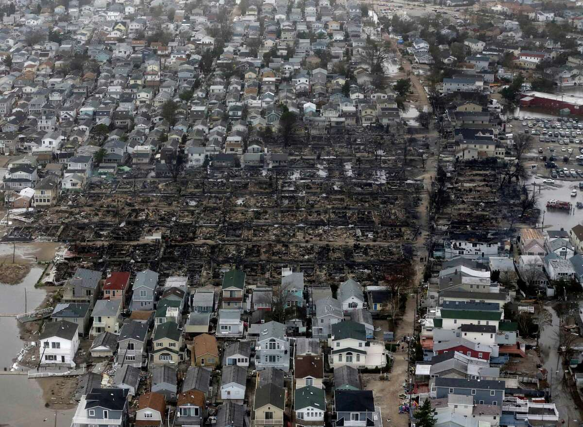 This aerial photo shows burned-out homes in the Breezy Point section of the Queens borough New York after a fire on Tuesday, Oct. 30, 2012. The tiny beachfront neighborhood told to evacuate before Sandy hit New York burned down as it was inundated by floodwaters, transforming a quaint corner of the Rockaways into a smoke-filled debris field.