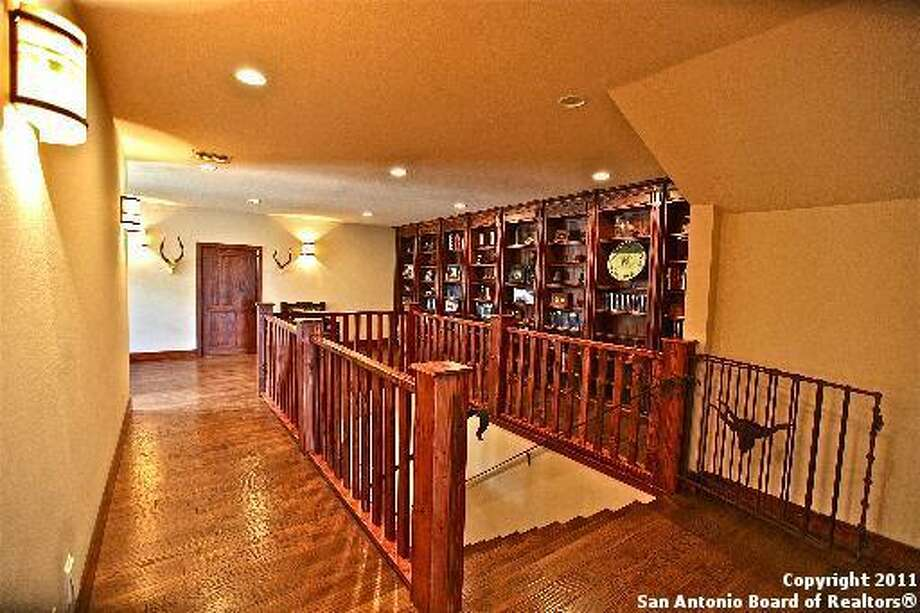 The upstairs has hardwood floors and built-in bookcases for storage and display.