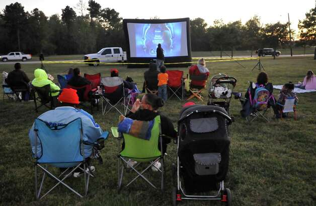 The Theodore Johns Library on Fannett Road in Beaumont hosted a free showing of Casper, the movie, Monday evening complete with popcorn and candy.Beaumont Parks and Recreation Department employees, handled the logistics of putting on the show and people brought their own lawn chairs and blankets.  Over 100 people braved the cold temperatures, wrapped in blankets, to see it.  Dave Ryan/The Enterprise Photo: Dave Ryan