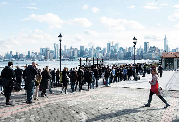 With limited functioning transportation options people wait for ferry tickets October 31, 2012 in Hoboken, New Jersey.  Hurricane Sandy which made landfall along the New Jersey shore, has left parts of the state and the surrounding area flooded and without power. Photo: BRENDAN SMIALOWSKI, AFP/Getty Images / 2012 AFP