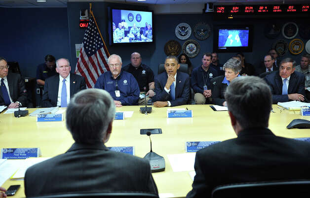 President Barack Obama(center) takes part in a meeting at FEMA headquarters (the Federal Emergency Management Agency) on October 31, 2012 in Washington, DC. Obama will be visiting New Jersey to visit areas hit hard by Hurricane Sandy. From left are: Energy Secretary Steven Chu, Deputy National Security Advisor for Homeland Security and Counterterrorism John Brennan, FEMA Administrator Craig Fugate, Homeland Security Secretary Janet Napolitano, and Defense Secretary Leon Panetta. Photo: MANDEL NGAN, AFP/Getty Images / 2012 AFP