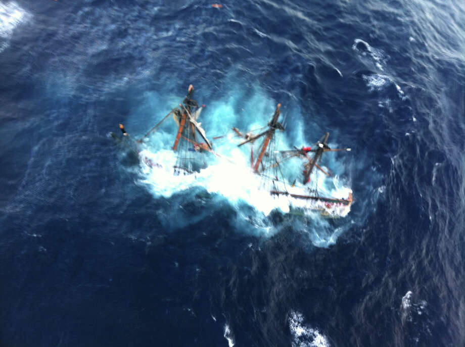 This photo provided by the U.S. Coast Guard shows the HMS Bounty, a 180-foot sailboat, submerged in the Atlantic Ocean during Hurricane Sandy approximately 90 miles southeast of Hatteras, N.C., Monday, Oct. 29, 2012. The Coast Guard rescued 14 of the 16 crew members by helicopter. Hours later, rescuers found one of the missing crew members, but she was unresponsive. They are still searching for the captain. (AP Photo/U.S. Coast Guard, Petty Officer 2nd Class Tim Kuklewski) Photo: AP, HOPD / New