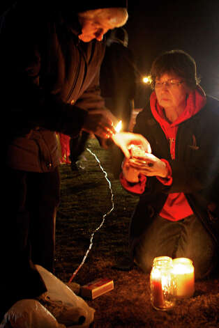 Leona Wieland, 65, of Sioux Falls, lights candles in peaceful protest with Sister Janice Klein, left, as they await the Tuesday, Oct. 30, 2012, execution in Sioux Falls, S.D., of South Dakota State Penitentiary inmate Donald Moeller. Moeller, 60, is set to die for the 1990 killing of 9-year-old Becky O'Connell. His death will mark the state's second execution this month. (AP Photo/Amber Hunt) Photo: Amber Hunt